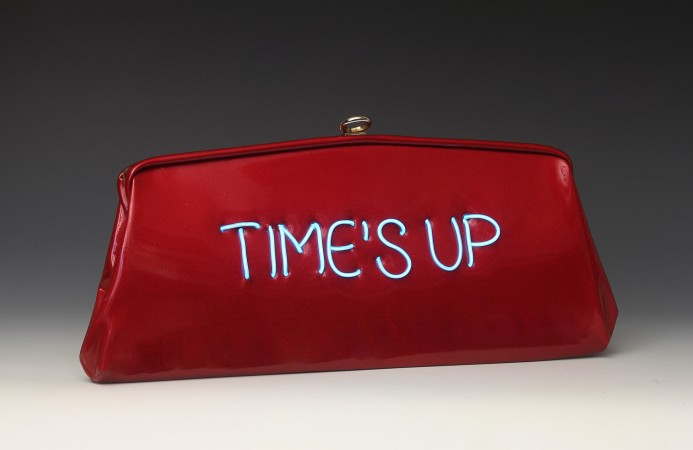 Time's Up, 2018, vintage purse with electroluminescent wire, 5 x 10 x 1.5 inches