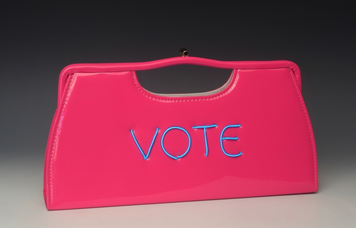 Power of the Purse: Vote For Equality, 2018, vintage purse with electroluminescent wire, 7 x 14 x 2 inches