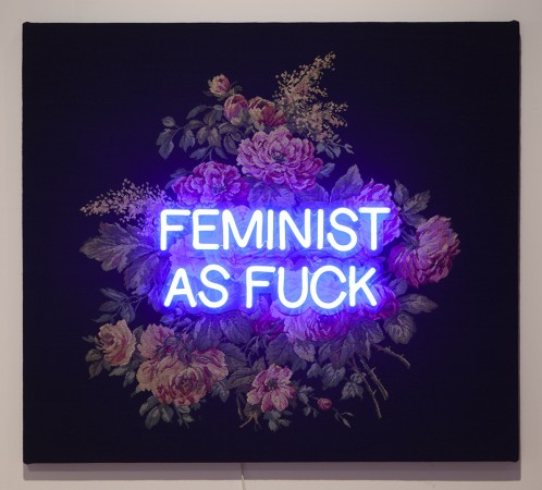 Feminist as Fuck, 2018, tapestry and LED neon, 45 x 51 x 2.5 inches