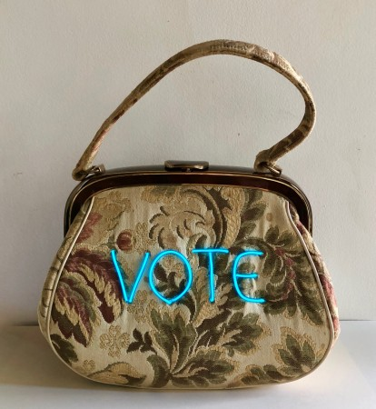 Michele Pred, VOTE 5/10, 2018, vintage purse with electroluminescent wire, 10 x 9 x 4 inches