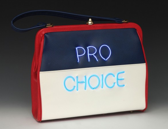 Michele Pred, Pred-a-Porter: Pro Choice - Red White and Blue, 2016, el wire on vintage purse, 10 x 10 x 3 inches