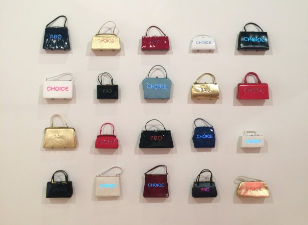 Pred-a-Porter: Pro Choice wall, 2015, electroluminescent wire on vintage purses, variable, edition of 48, Sold individually or as an installation