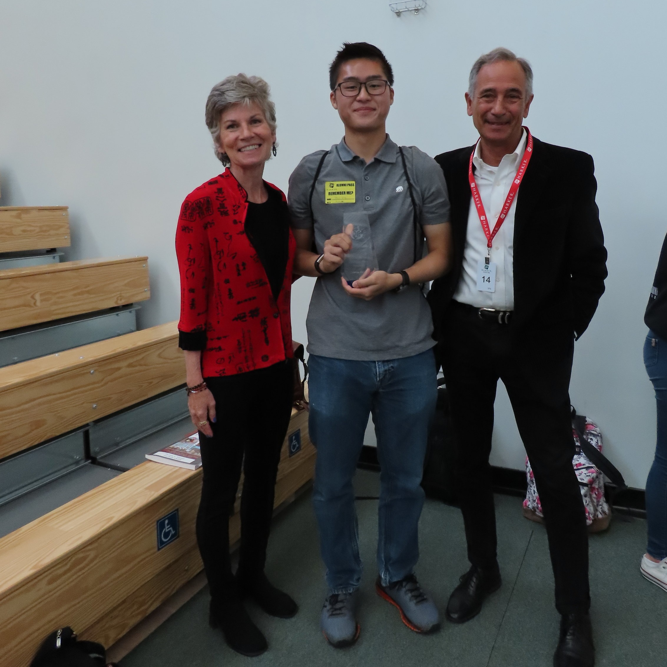 Kristina and Tom, from TFI, present Zachary (center) with his award