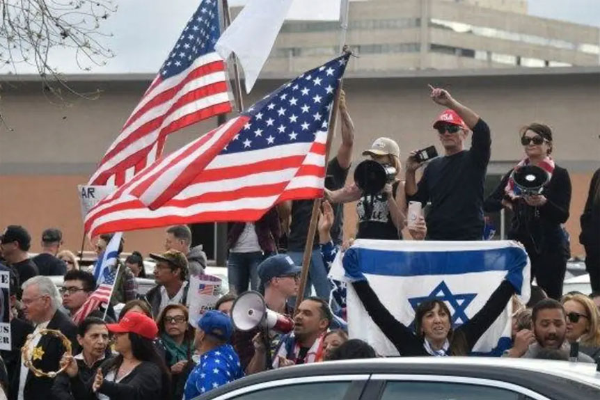 Stop Antisemitism staged a large protest outside the Hilton Hotel in Los Angeles where Ilhan Omar was speaking on March 23, 2019. (photo credit: Gene Blevins)