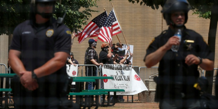 Members of the white nationalist group the Honorable Sacred Knights of the Ku Klux Klan hold a rally in Dayton, Ohio, May 25, 2019.jpg
