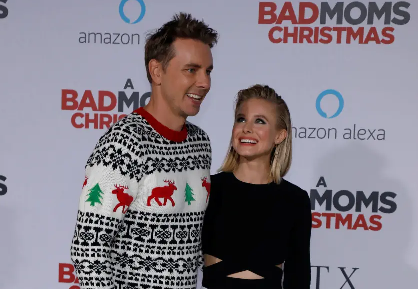 "ast member Kristen Bell and her husband Dax Shepard pose at the premiere for ""A Bad Moms Christmas"" in Los Angeles, California. (photo credit: REUTERS)"