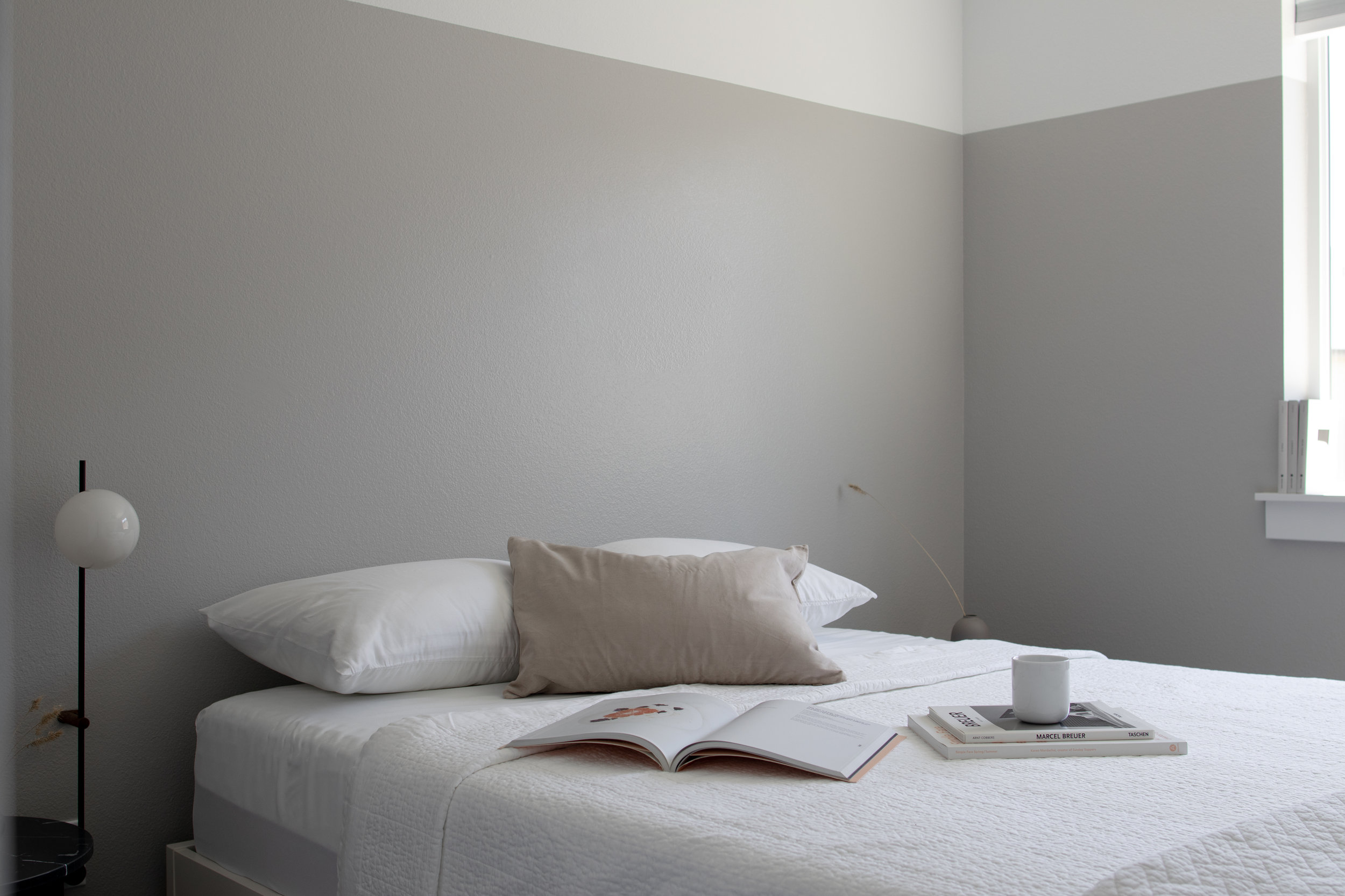 Minimalist guest bedroom in muted tones