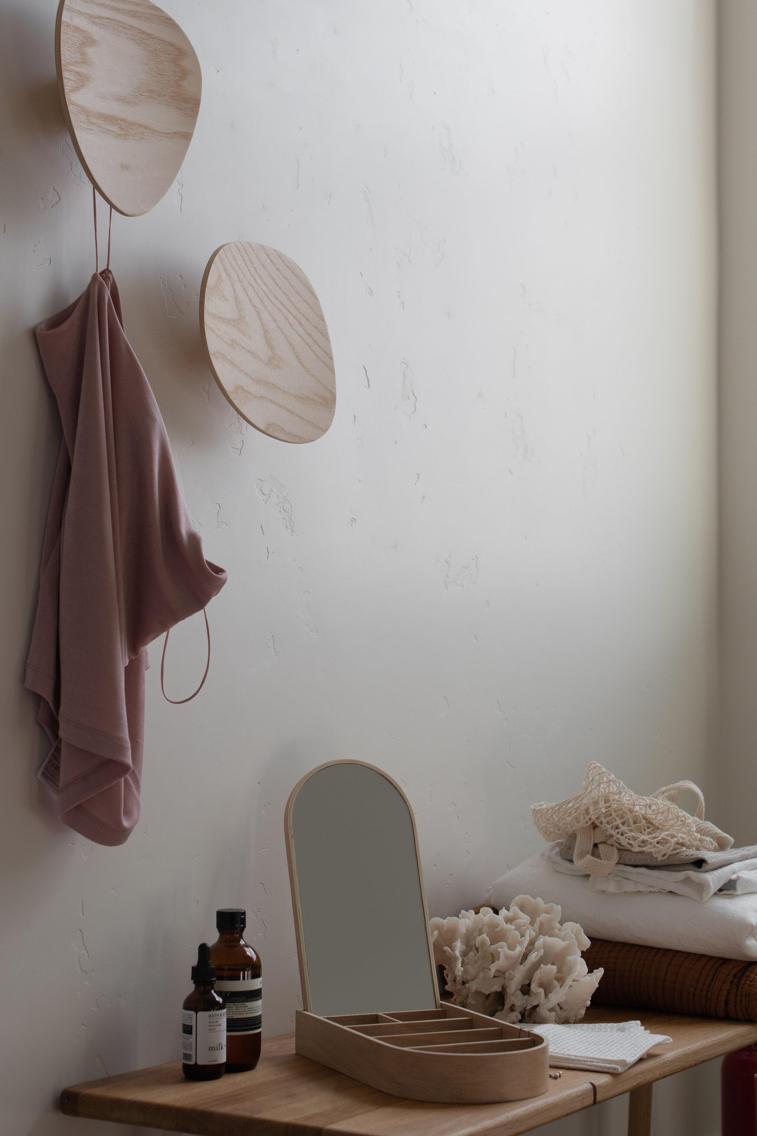 Closet area with light oak wall hooks