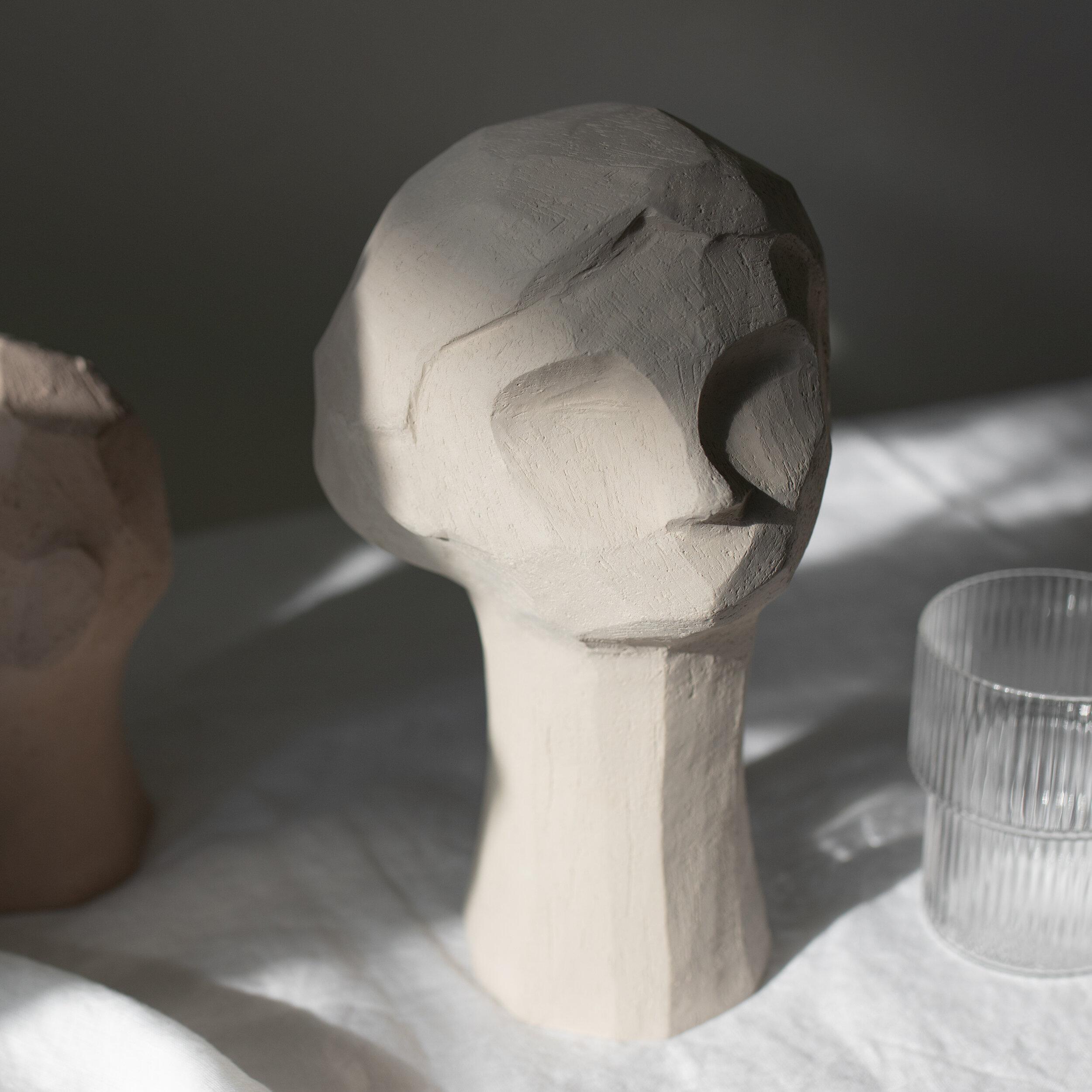 Kristiina  sculpture on my table, enjoying the afternoon light.