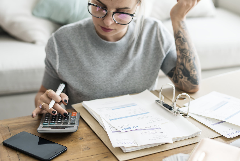 caucasian-woman-with-invoice-bills-PW6PDBS.jpg
