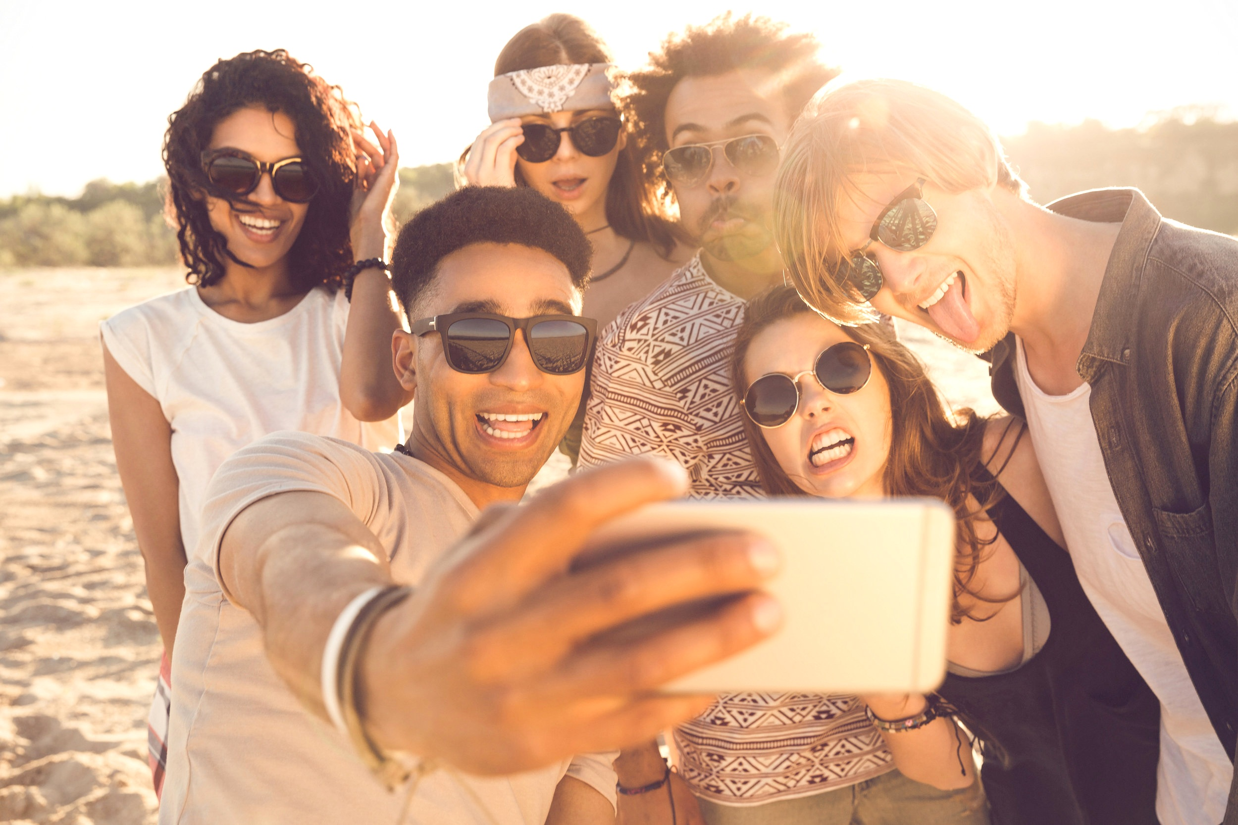 multiracial-group-of-friends-taking-selfie-PCYJRGQ.jpg