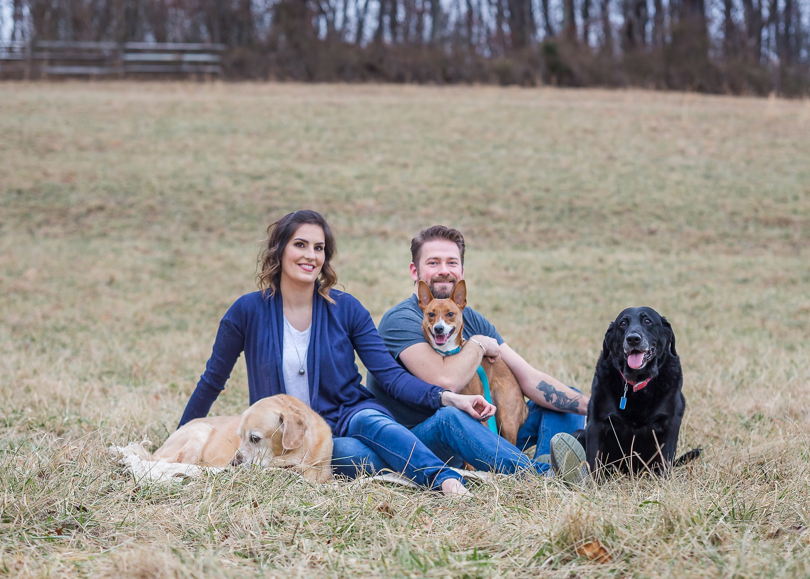 Maggie's Farm founders Tim and Layla Russell with their three rescue dogs, Crosby, Lumi, and Blake.