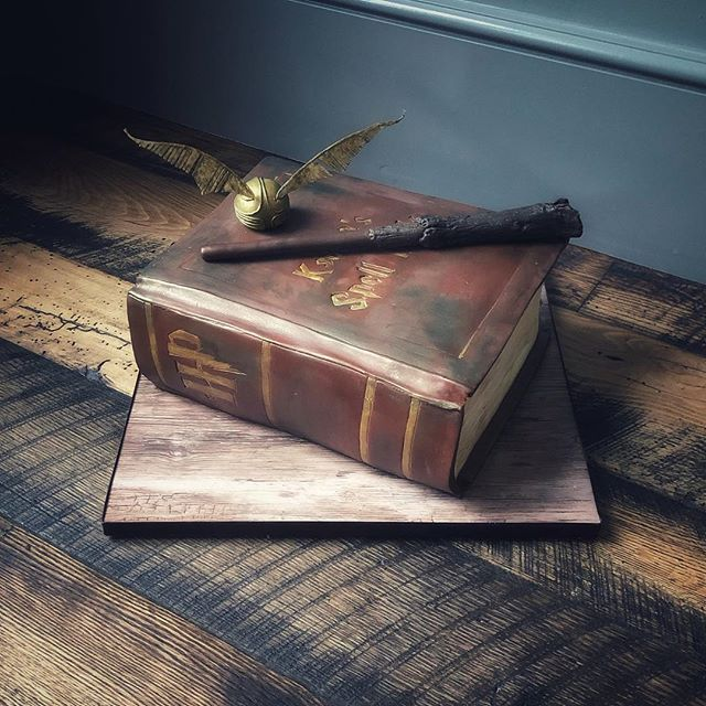 Harry Potter Spell Book cake, complete with custom embossed book spine and cover, edible Snitch and wand.
