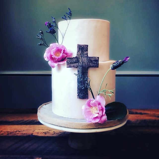 Elegant rustic First Communion cake featuring gluten-free dairy-free chocolate cake, non-dairy chocolate ganache, raspberry marshmallow fondant, hand-made distressed wood cross, fresh lavender and blooms.