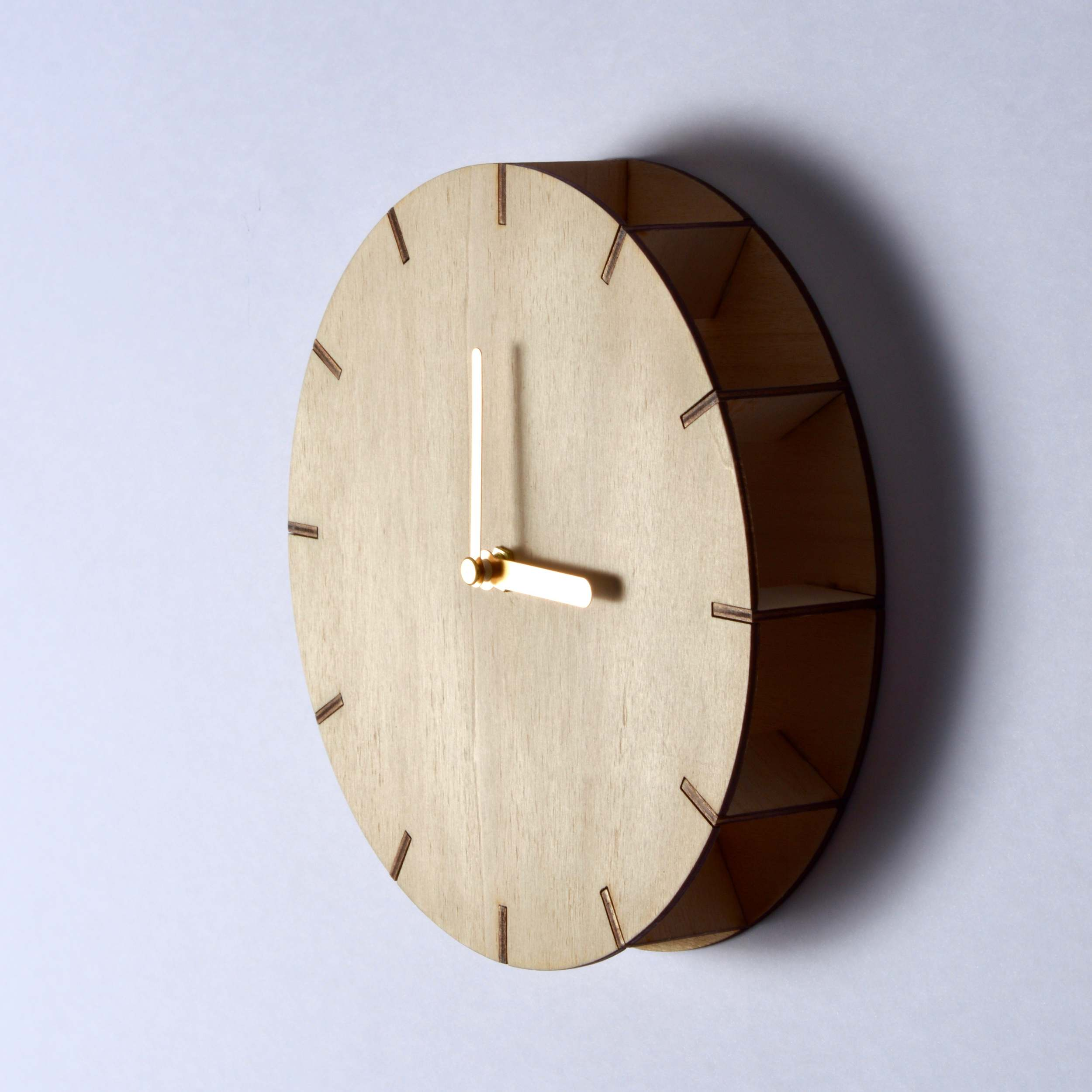 Wall-Tic clock - The Wall-Tic clock is a wall mounted variety of the Table-Toc cock. Made from laser cut plywood.