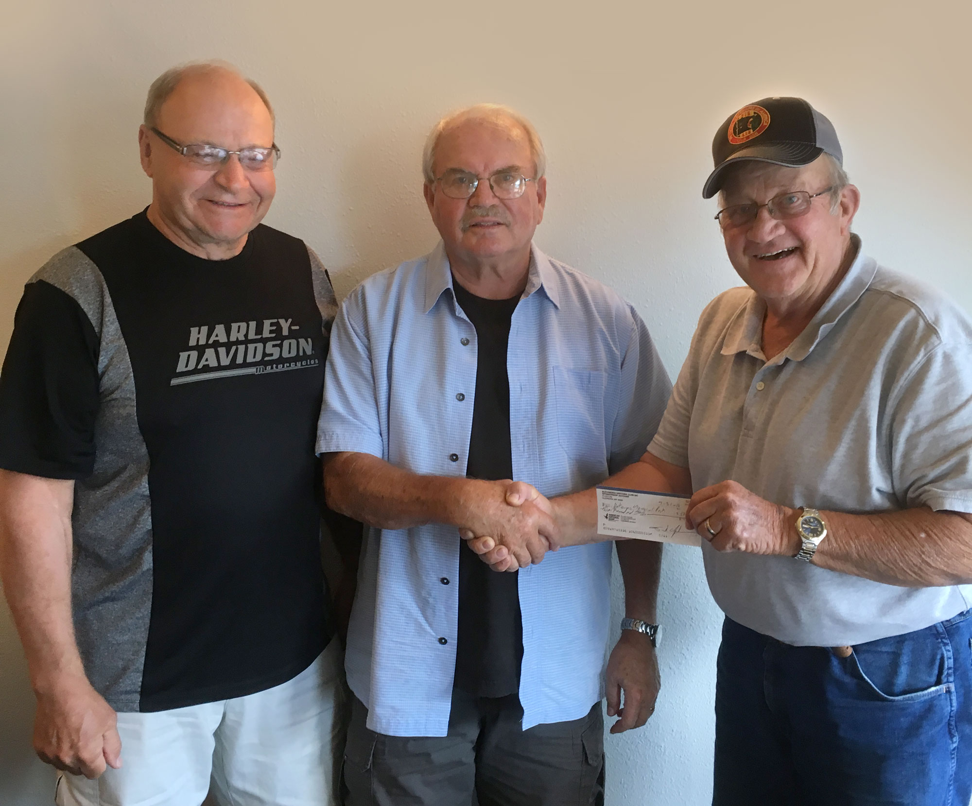 Don Johnson (center) presents a $5,000 check from the Sertoma Club on July 26, 2018 to Grant Haugen (left) and Gabe Pipo (right) accepting on behalf of the Veterans Memorial Park Finance Committee.