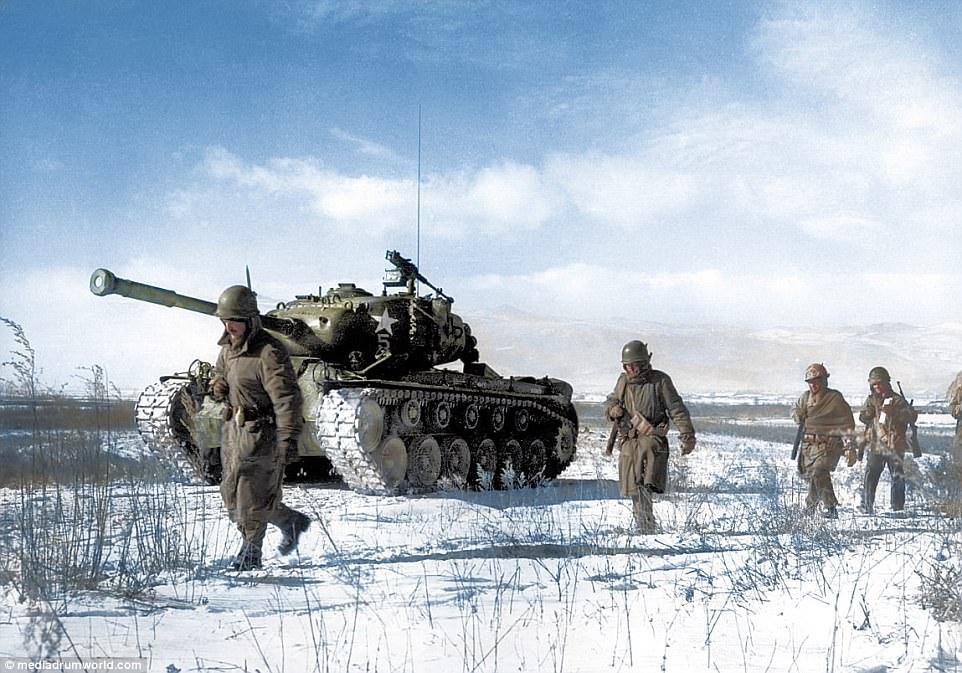 406D809A00000578-4514562-US_troops_trek_through_the_snow_during_the_Korean_War_The_soldie-a-59_1495023868162.jpg