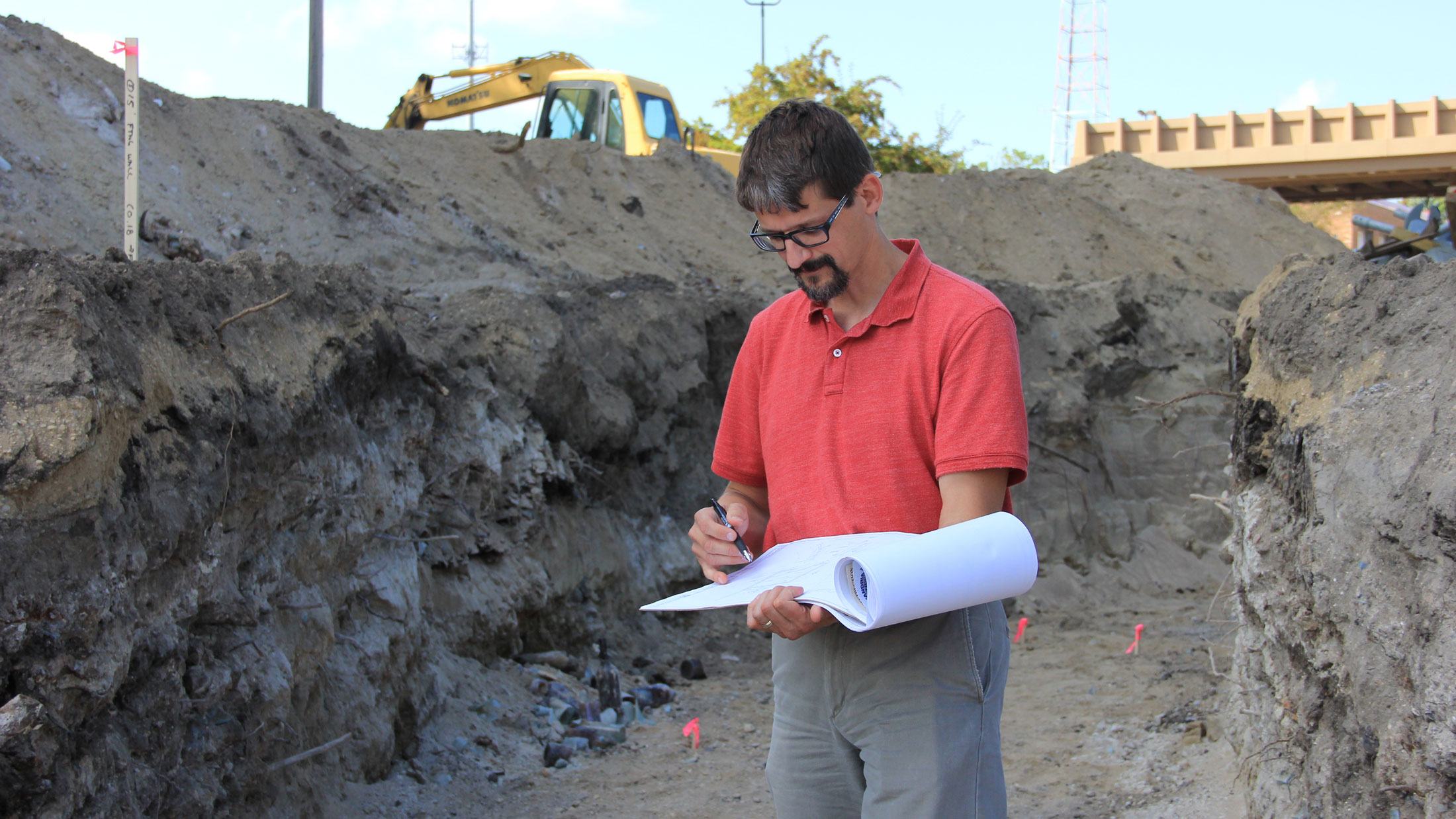 Architect checks for location of footings to be poured.