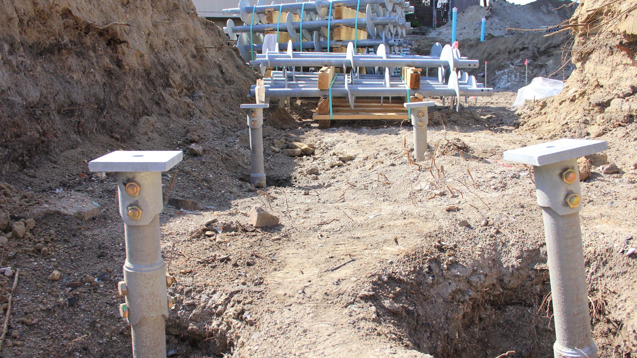 Helical piles have been turned into the ground.