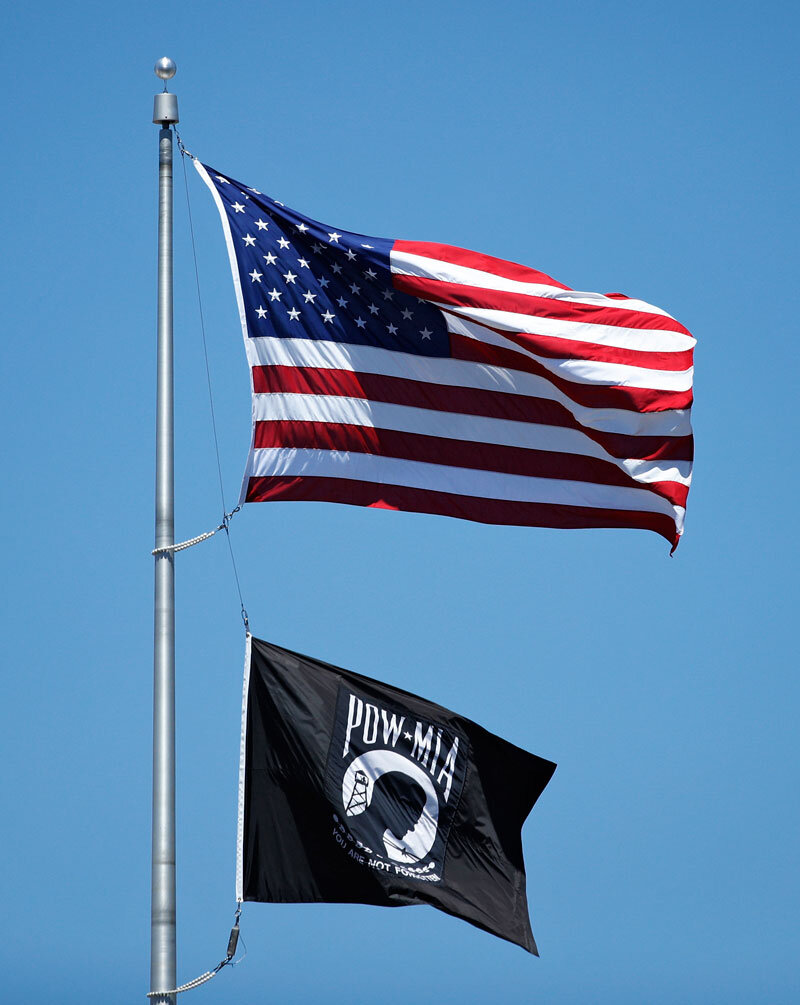 U. S. flag and POW/MIA flag are flying together