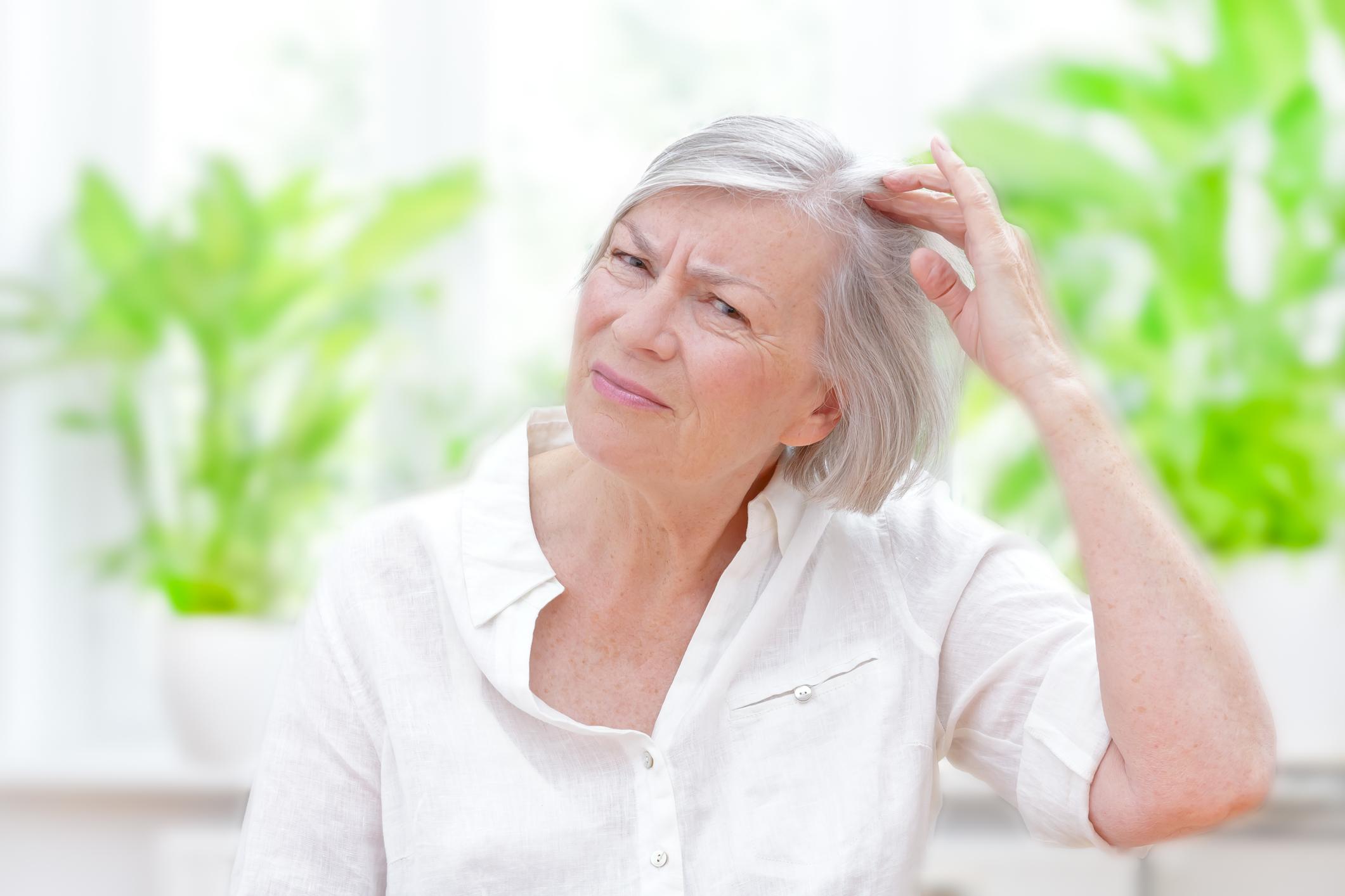 senior woman thinning hair loss