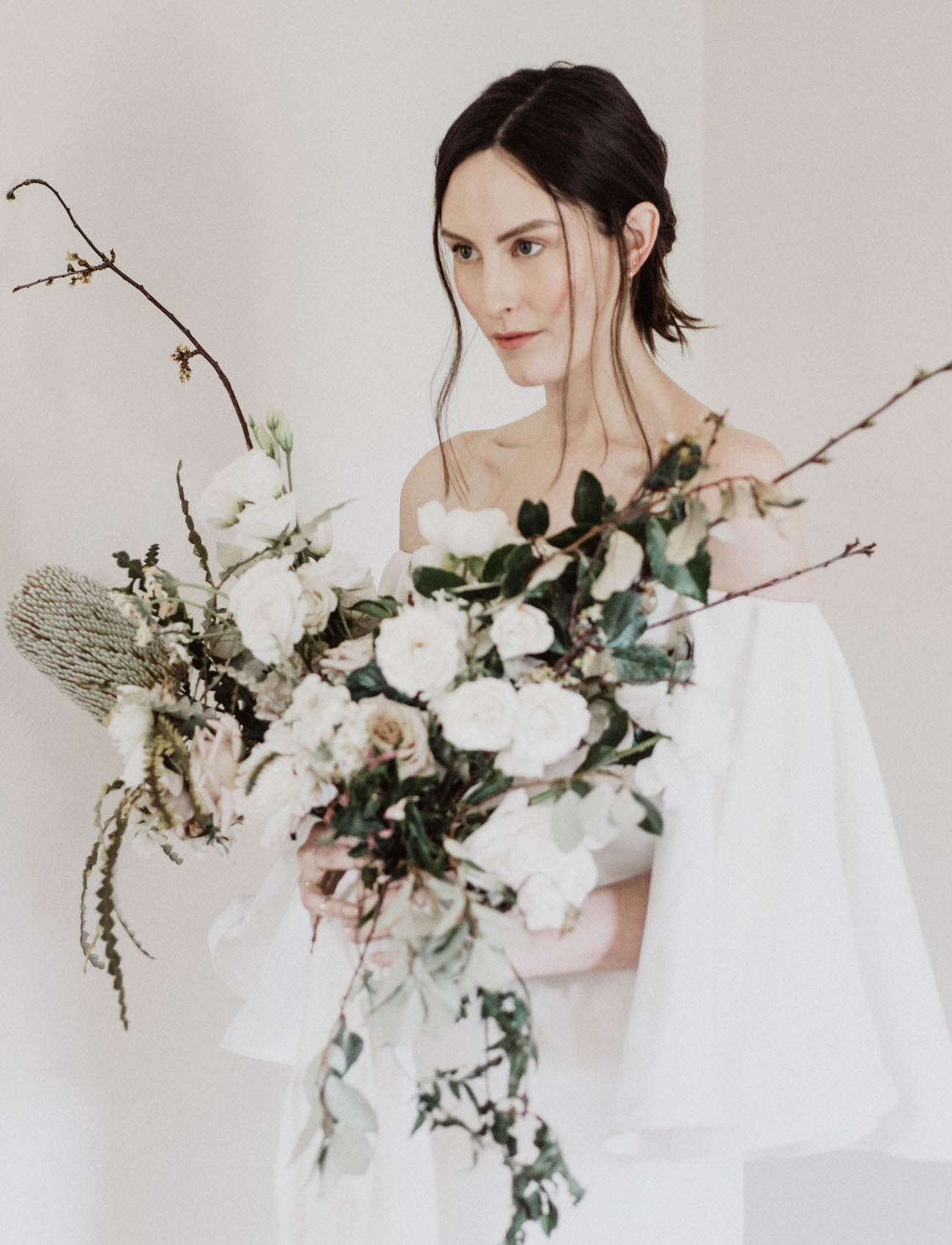 Minimal & Moden Vow Renewal - Featuring:Planner: Bash Co EventsPhotographer: aseaofloveDress: Houghton NYCHAMU: Walter FuentesPaper: Alli K