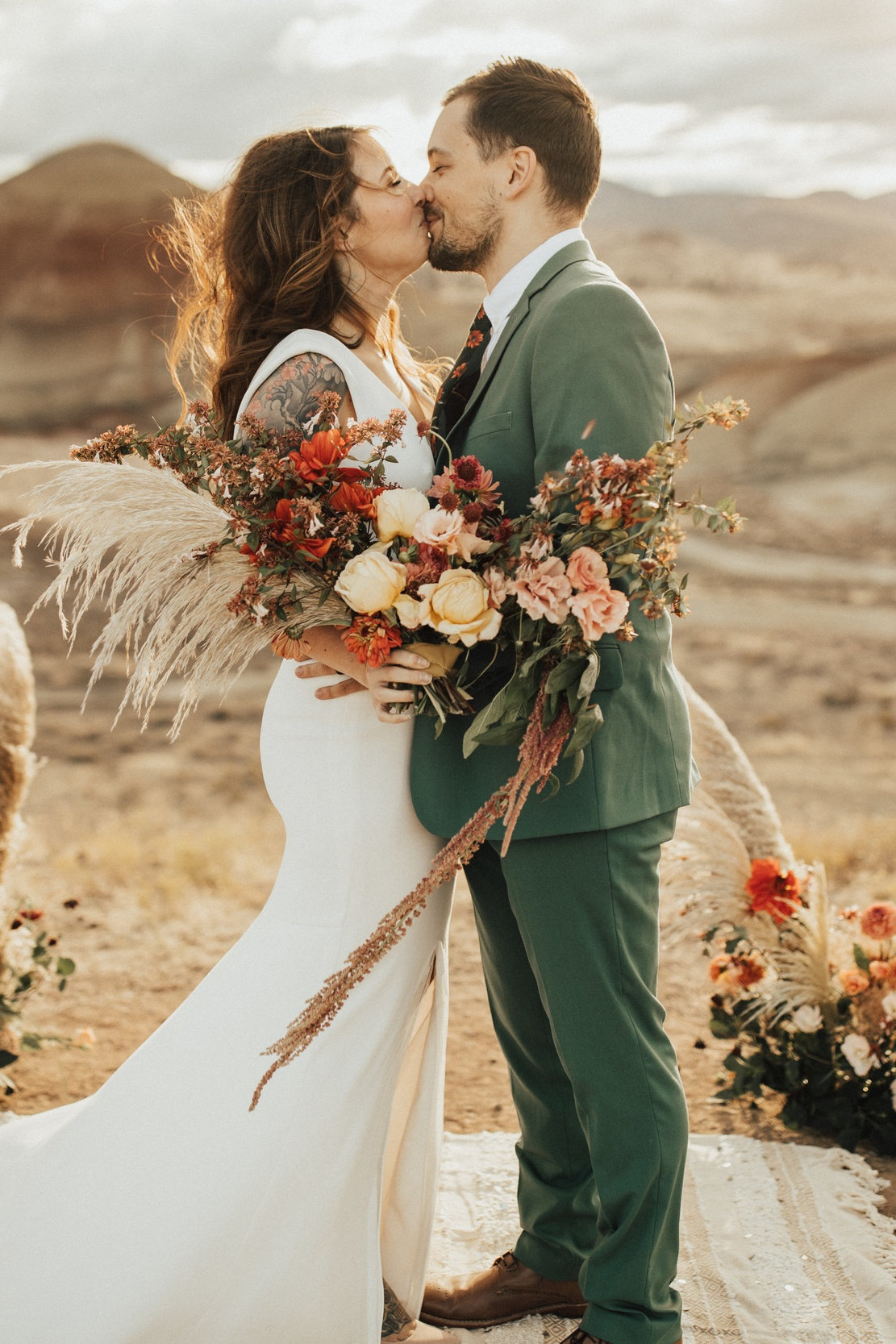 A Painted Hills Elopement - Featuring:Photography: Lauren NicoleStyling: Rock and StoneHAMU: Pacific BridesCake: Sift and GatherDress: a & bè bridalshop