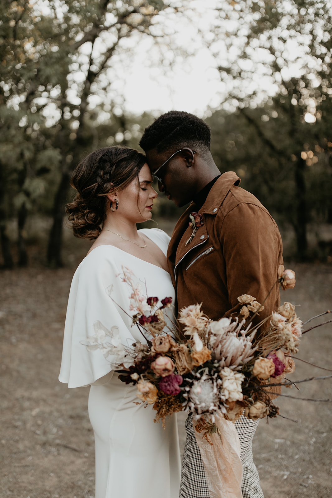 Moody Hygge Elopement - Featuring:Styling: Originally ScoutPhotography: Liesl ClairVenue: The ForgeHAMU: Well Beyond BeautyDress: Lovely Bride