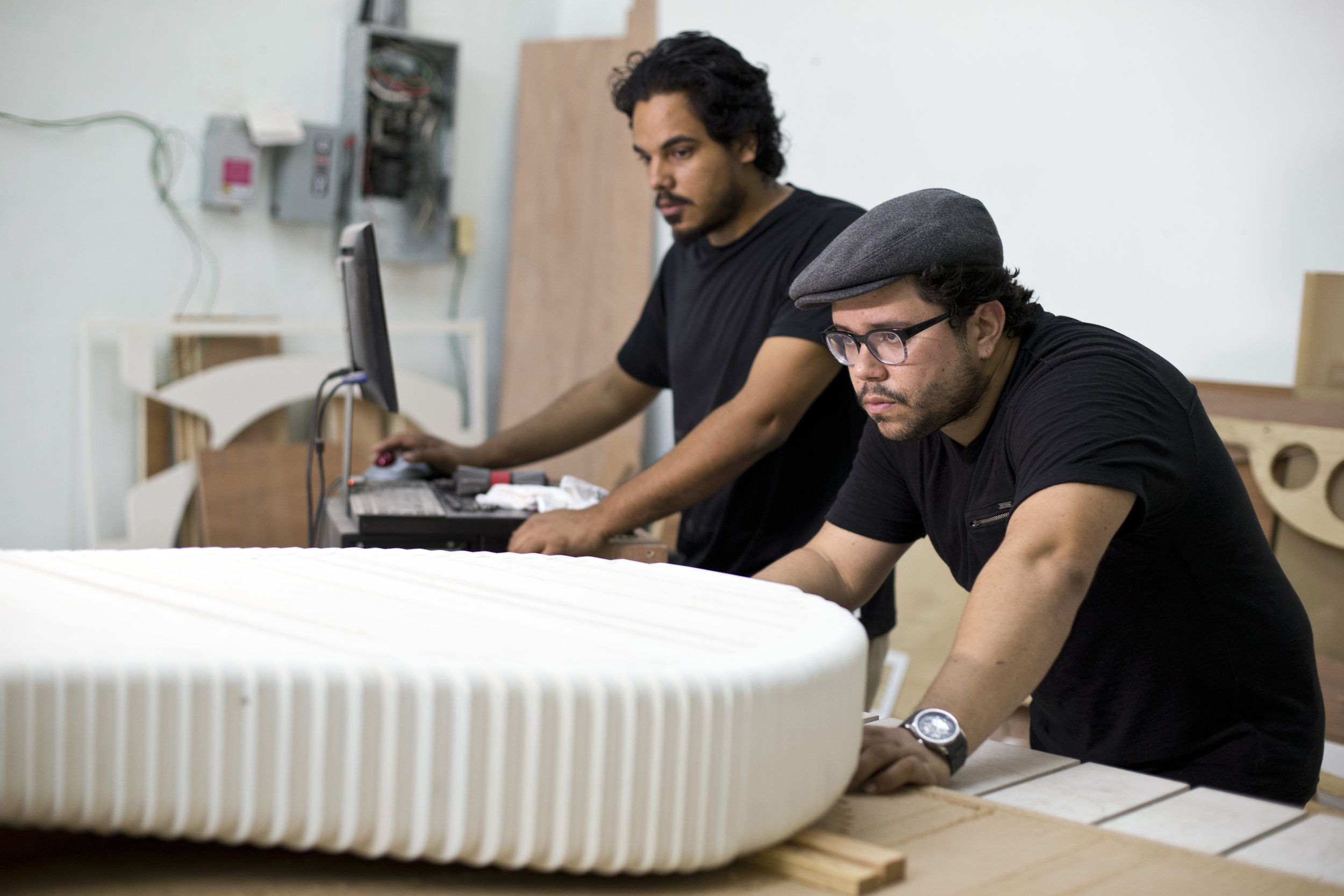 Javier (left) and Oscar (right) in Constructo's workshop. 2012