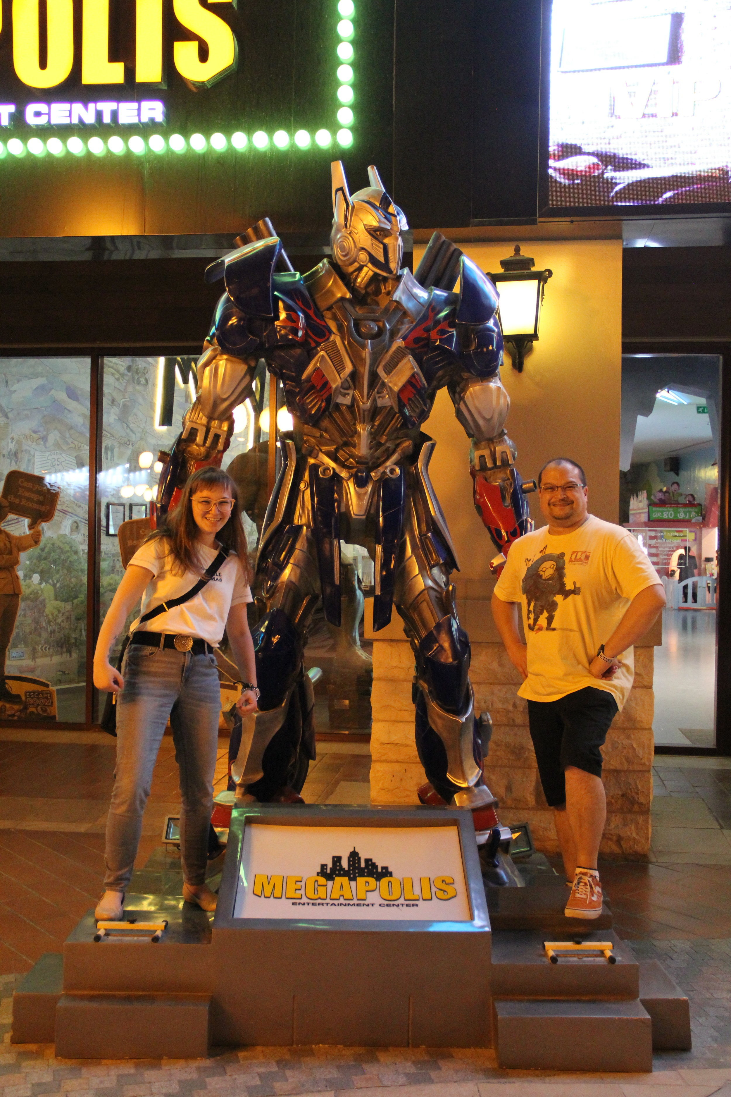Megapolis, The Pearl, Doha, Qatar. My dad and I posing with Optimus Prime.