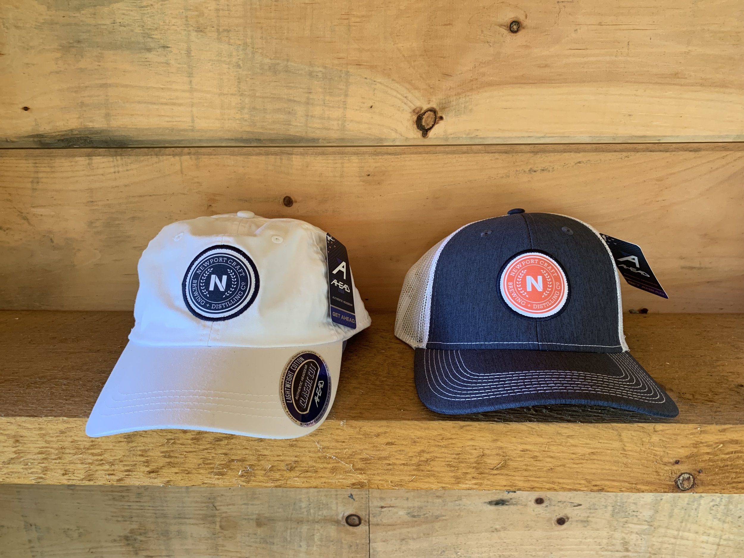 Hats $20 - Newport Craft hats available in white or navy blue netted.