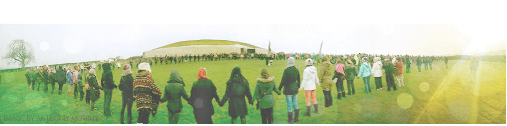 Picture by Anthony Murphy of Mythical Ireland    2014 Winter Solstice Picture : with people holding hands around Newgrange - community circle at the annual solstice gathering.