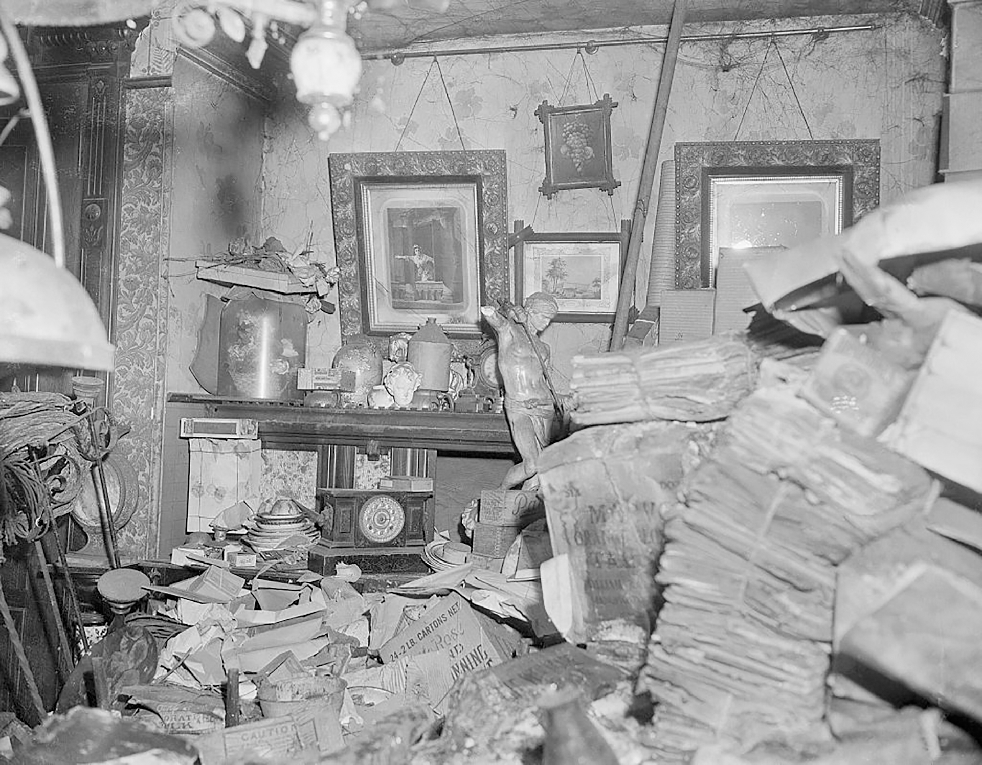 Getty Images: Room in house of Langley and Homer Collyer, well known eccentric and reclusive brothers who were found dead in 1947 in their Fifth Avenue, New York City brownstone buried amid 180 tons of junk.