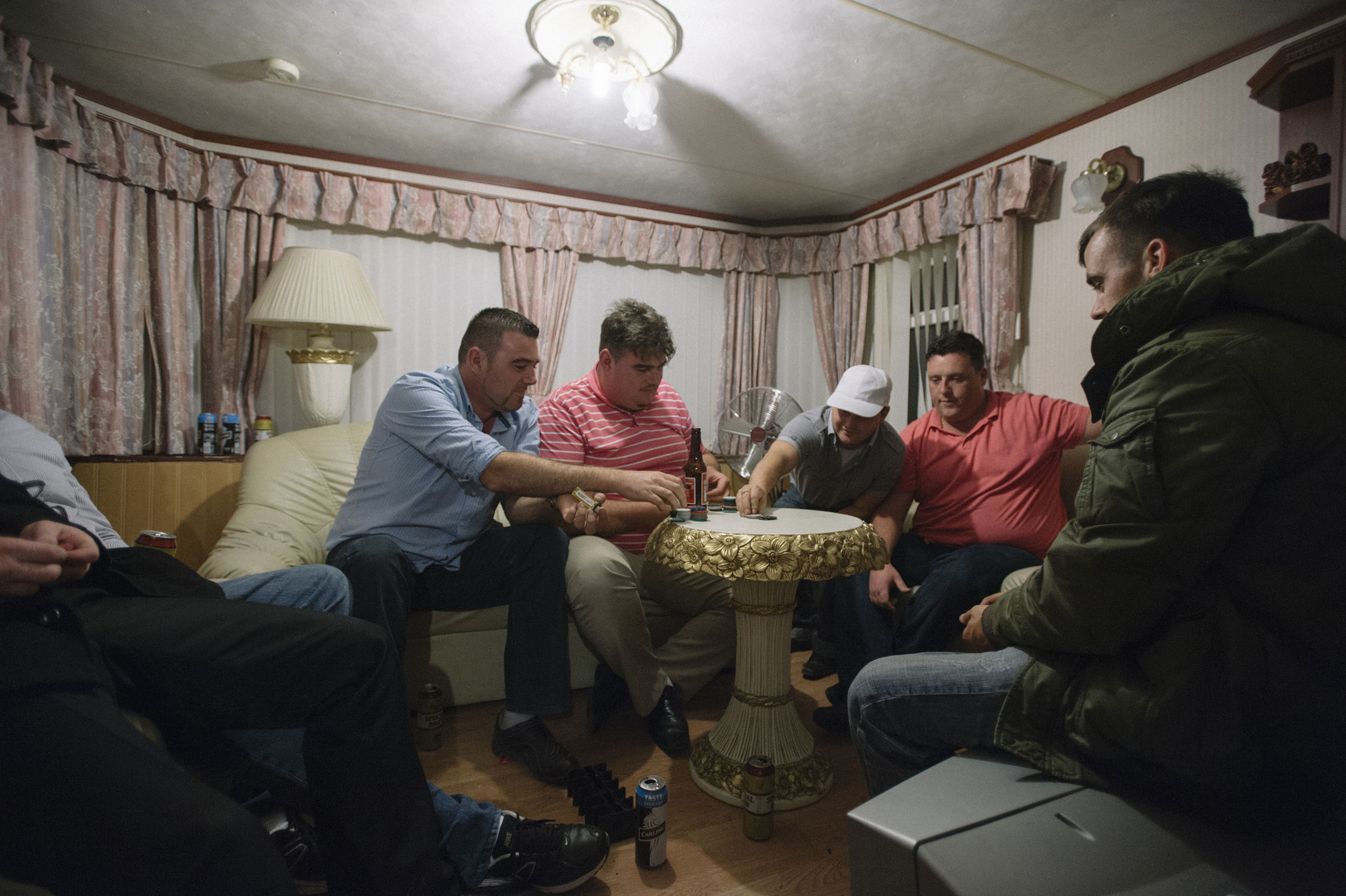 A group of Dale Farm residents celebrate a temporary court injunction against eviction with a game of poker.