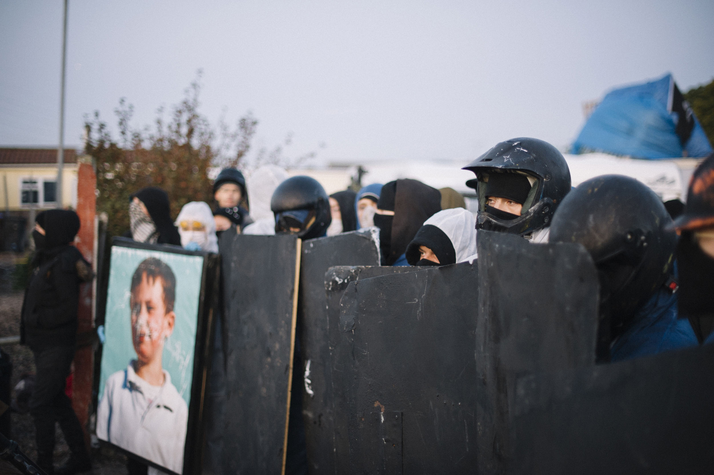 Protesters wear head protection and shields in preparation for clashes with police.