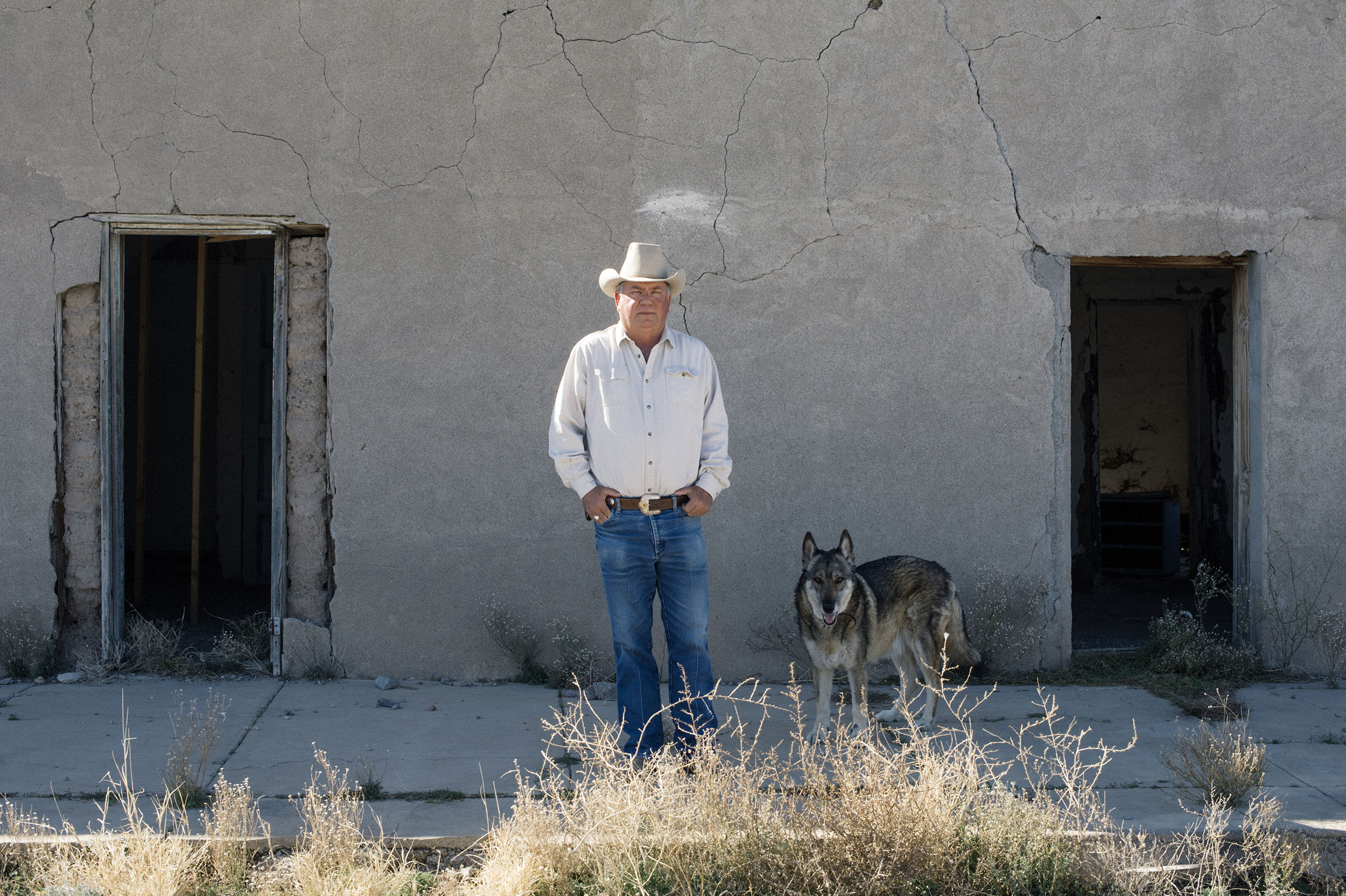 Terry Bishop and his wolf in Presidio. Bishop campaigns against the Trans-Pecos Pipeline.
