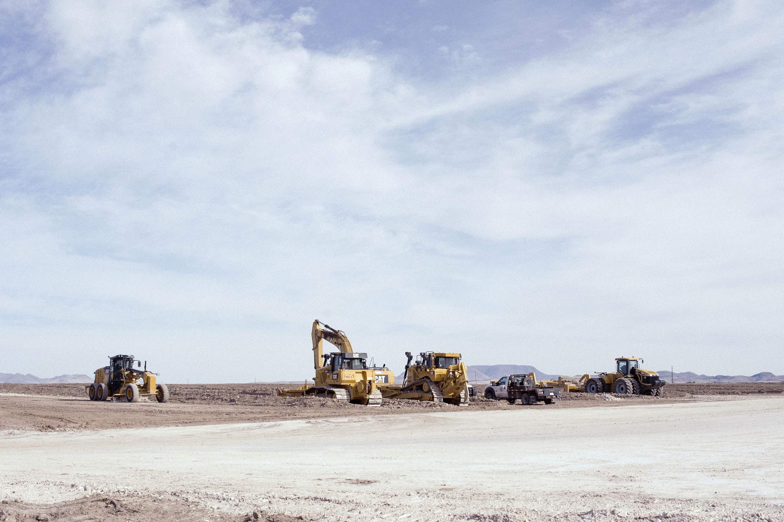 Machines clear an area of private land, on Nopal Road on the edge of Marfa, Texas.