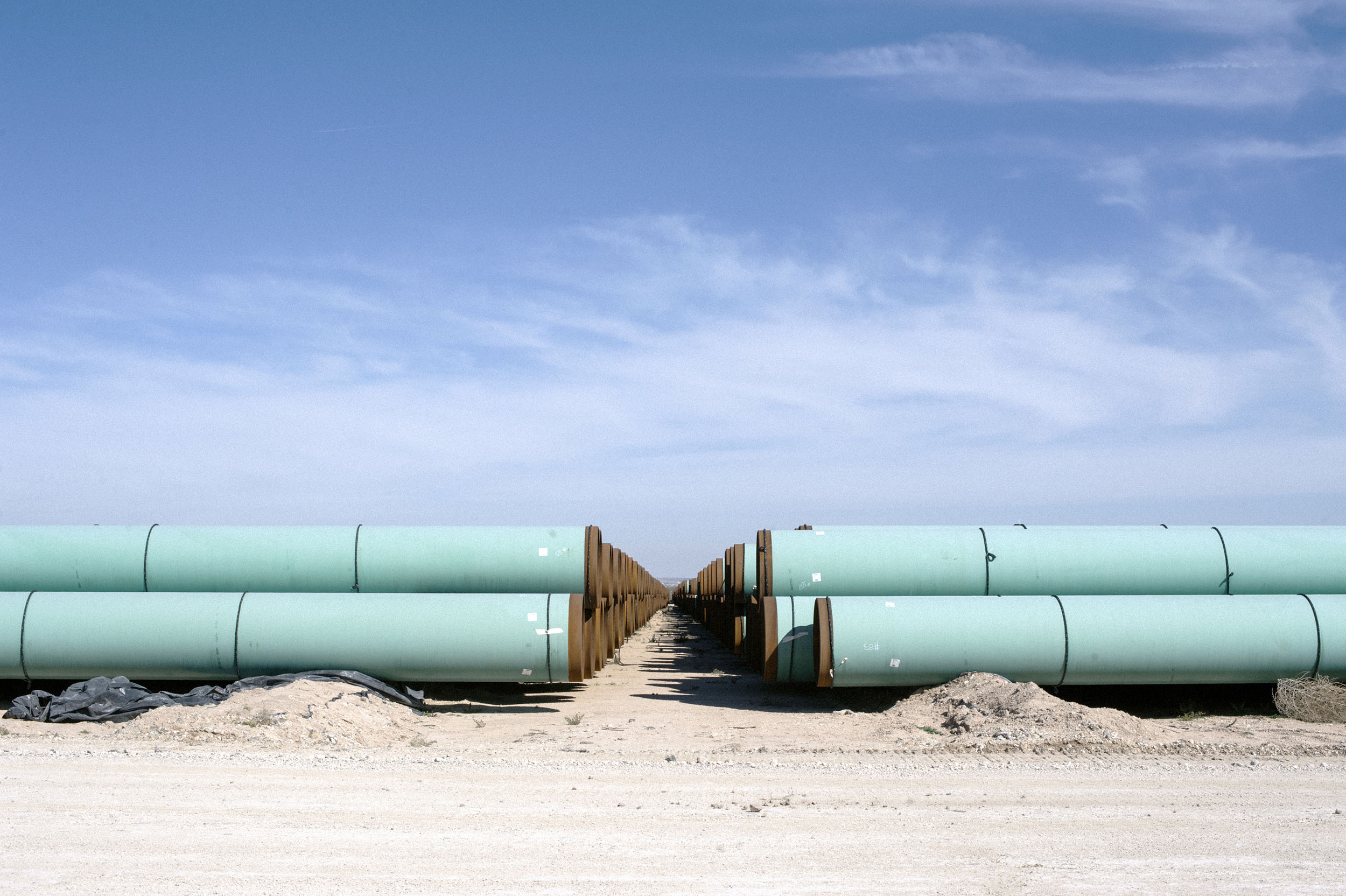 42 inch gas pipe stacked at Energy Transfer Partners' storage yard in Fort Stockton, Texas.