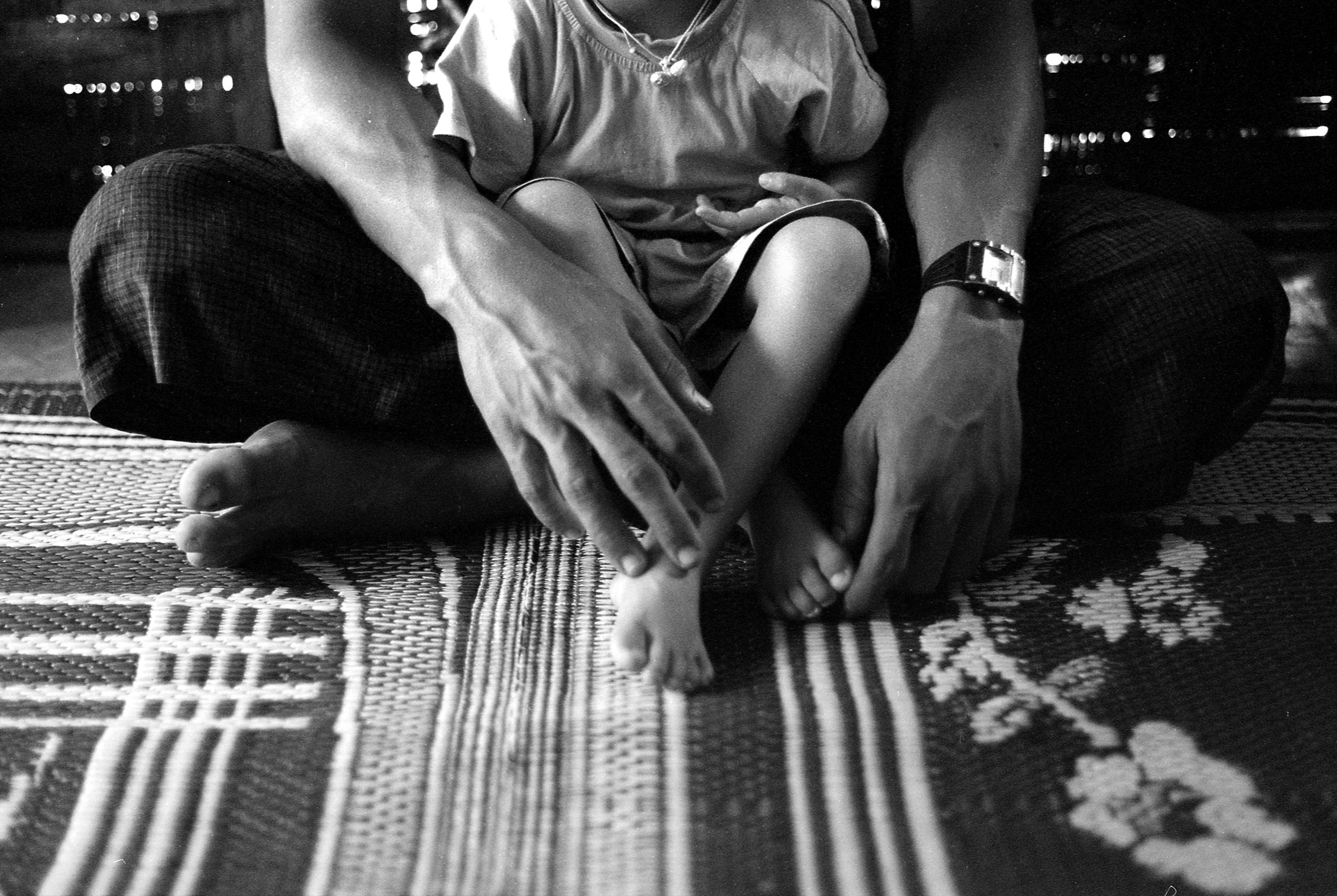 Kyaw Thura reunited with his four year old son. He was a child soldier, incarcerated for many escape attempts.