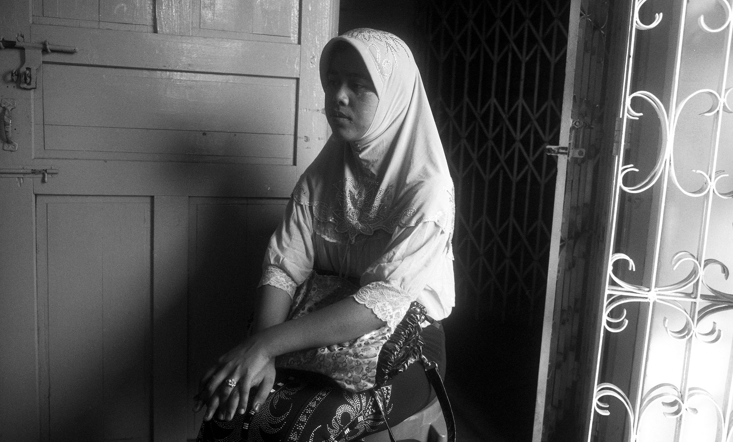 A woman attends a secret support and education group for young Muslims in Yangon.