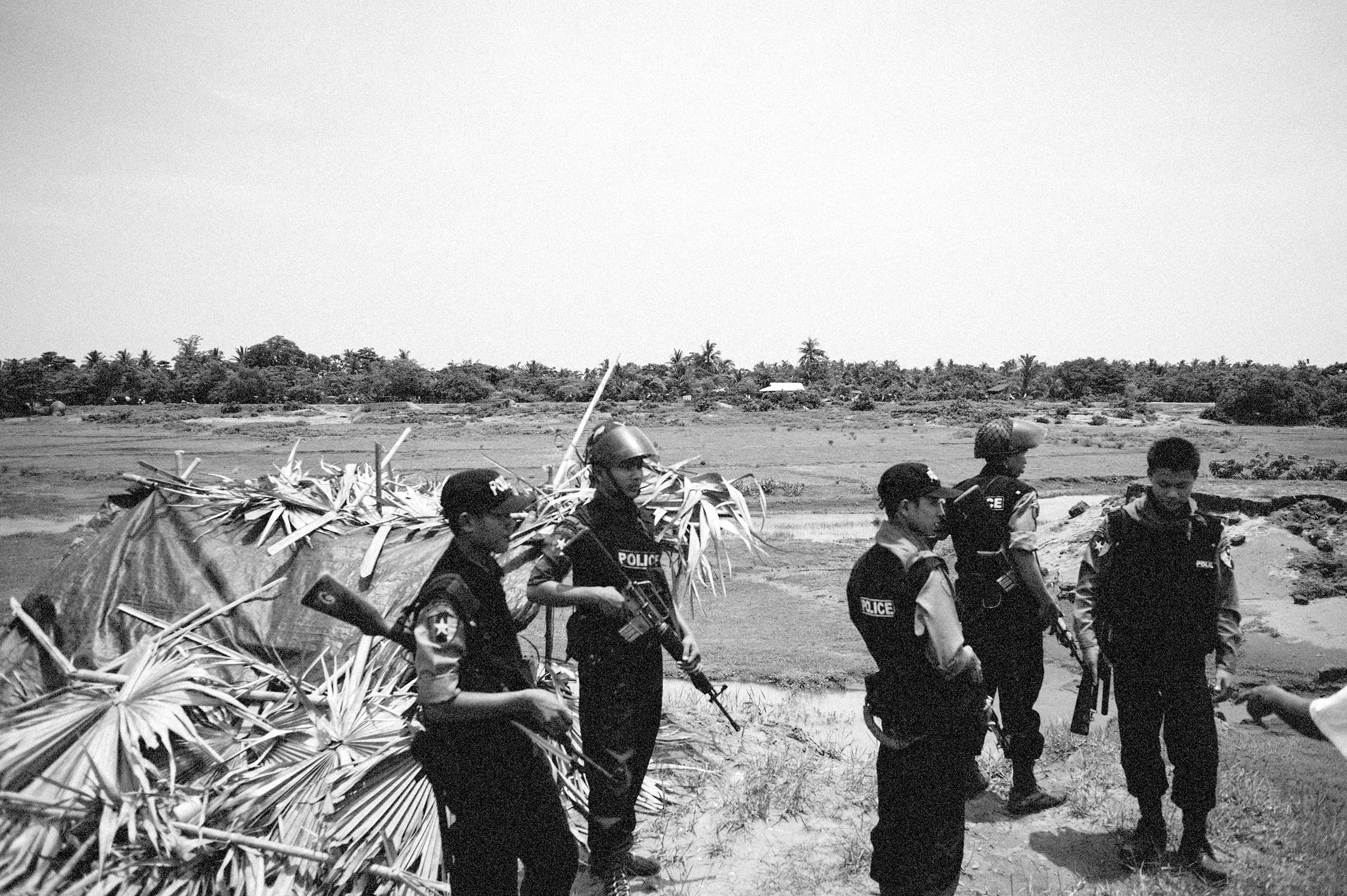 The police patrol border areas between Buddhist and Muslim in Sittwe.