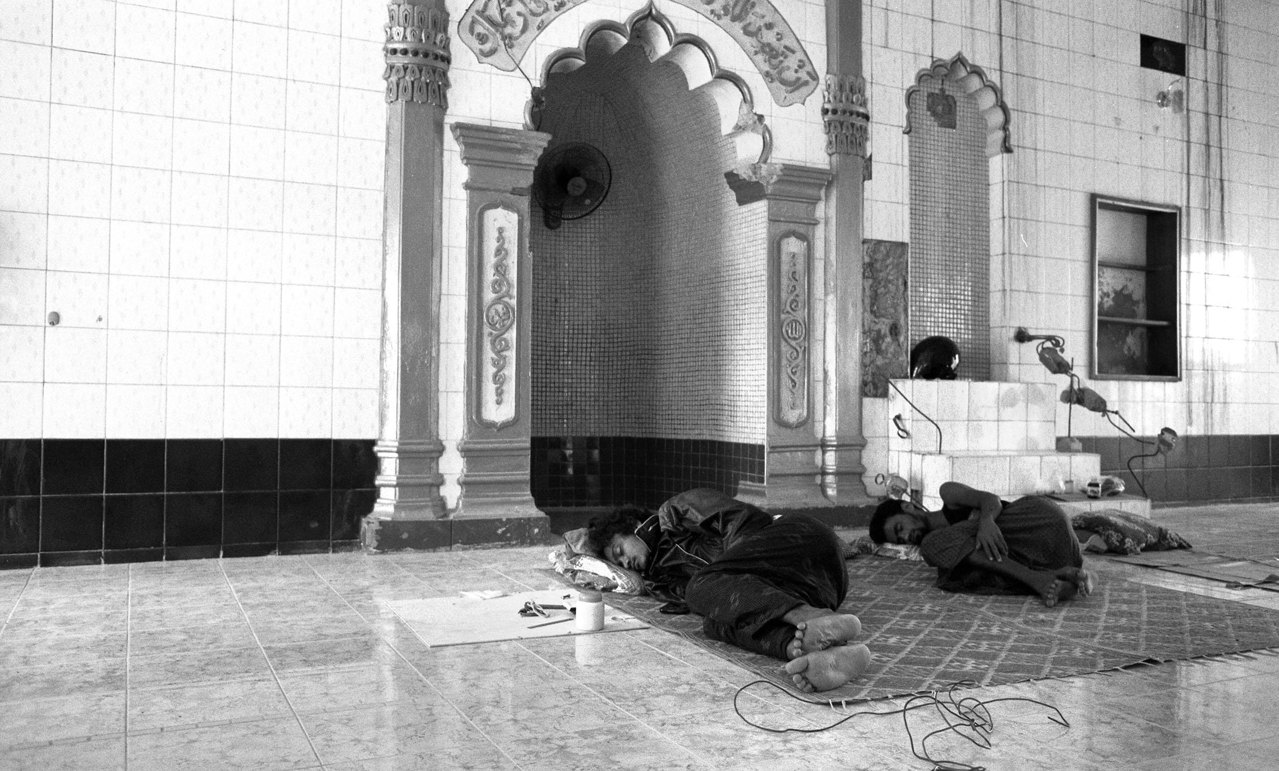Meiktila. Muslim men rest while rebuilding their Mosque after it was damaged in fighting.