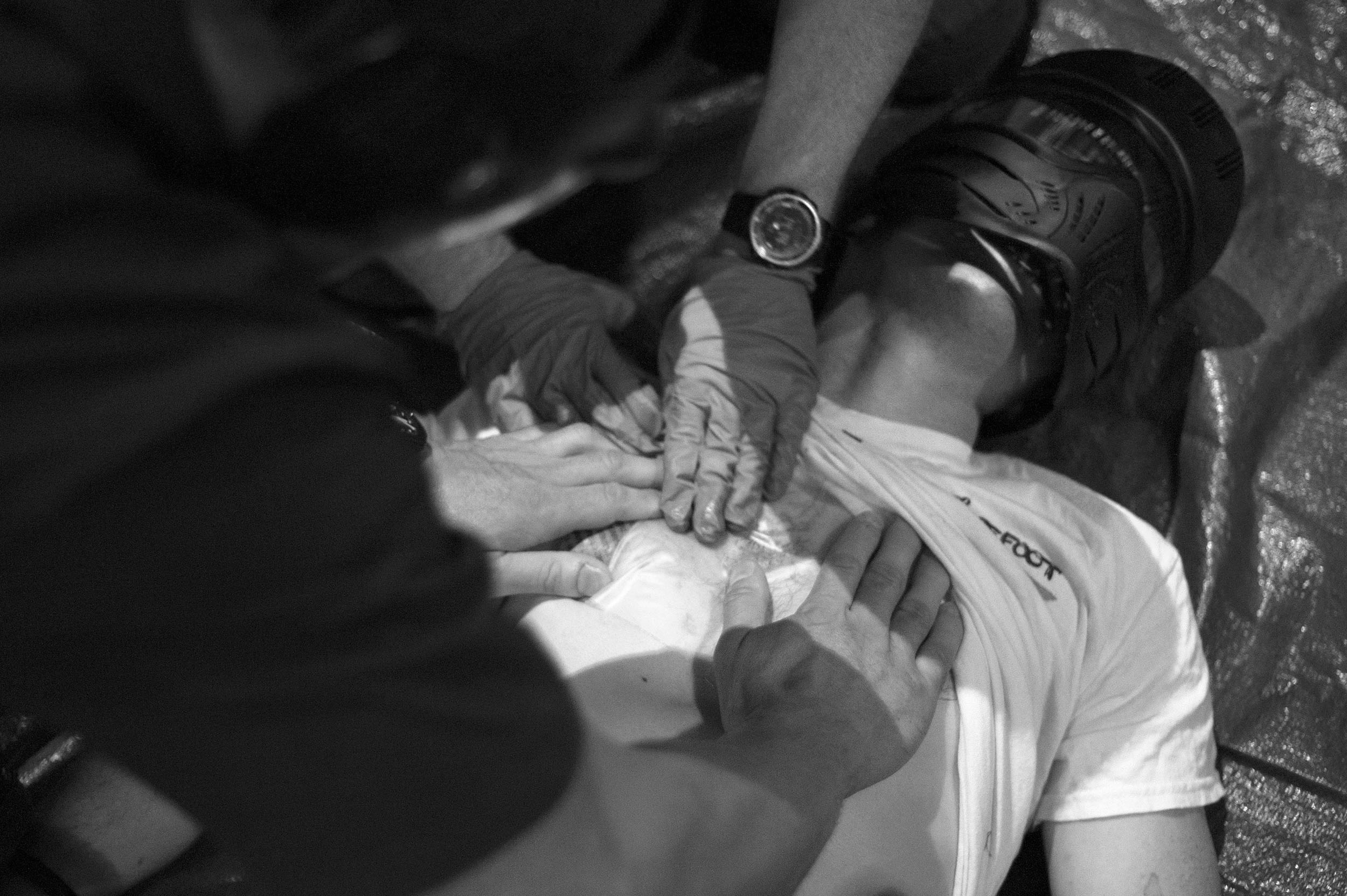 Paramedics demonstrate gunshot trauma treatment in a course aimed at students and teachers.