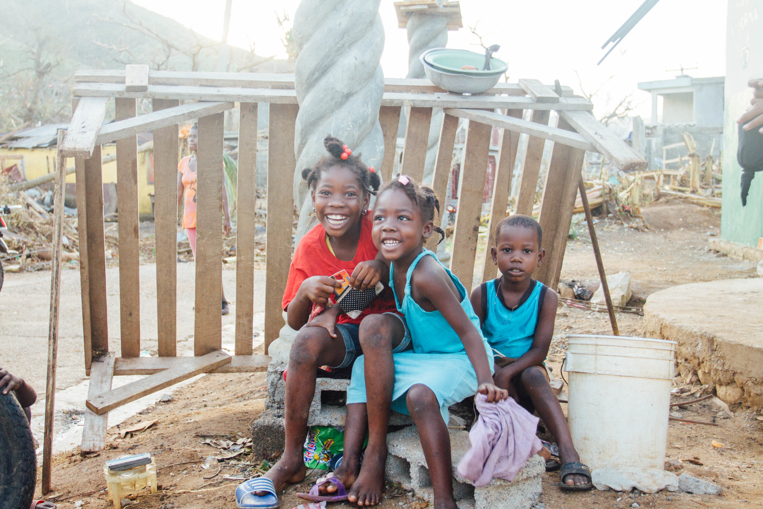 October 10th  - R E S I L I E N T. When people ask me about the Haitian people, that's the first word that comes to my mind. It's truly beautiful to see their resilience & strength. Would you please continue to pray for these people & support relief going to those who have endured so much suffering? The relief efforts are only just beginning. There is so much devastation to overcome. As we walked through this village at sunrise, these joyful little beauties were yet another reminder that the darkness WILL NOT drive out the light.""