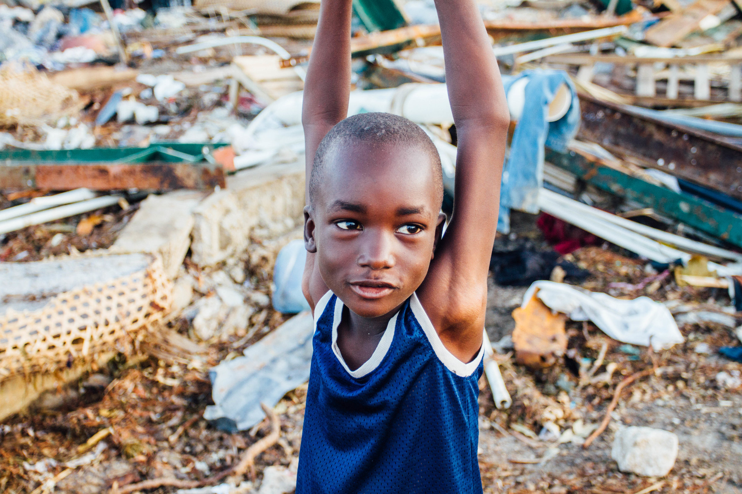 October 22nd  - This is Marvens, a soft spoken little guy from Anse d'Hainault, standing in the midst of his decimated village. . I'm headed back to Austin after spending a couple weeks helping with relief efforts after Hurricane Matthew swept through Haiti. . The days have gone by in a blur, but when I look back on the past 16 days in Haiti, the words that come to mind are: devastation, unity, desperation, resilience, survival, strength, & HOPE. . As the rebuilding continues, my anthem for the Haitian people is Romans 12:12 - Rejoice in Hope. Be patient in tribulation. Be constant in Prayer. . What the enemy means for evil, God will use for good. I've firsthand seen the beginnings of this & know that He is faithful.