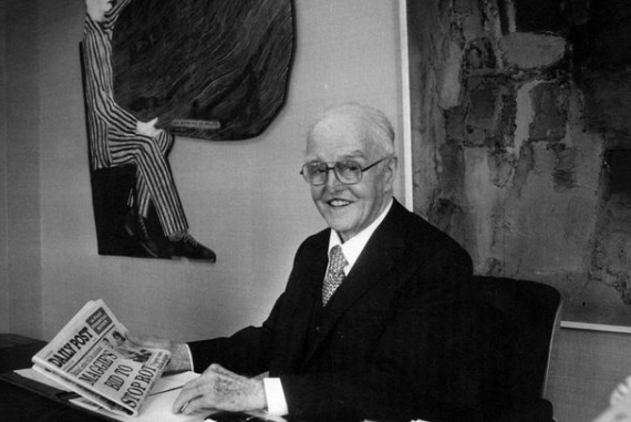 Sir John Moores in his study