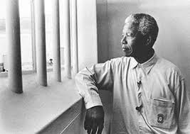 Nelson Mandela in his cell on Robben Island