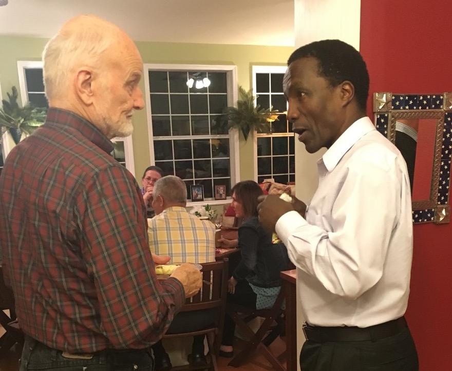 Tim Lewis of Frontiers talking with Mutua Mahiaini of Navigators
