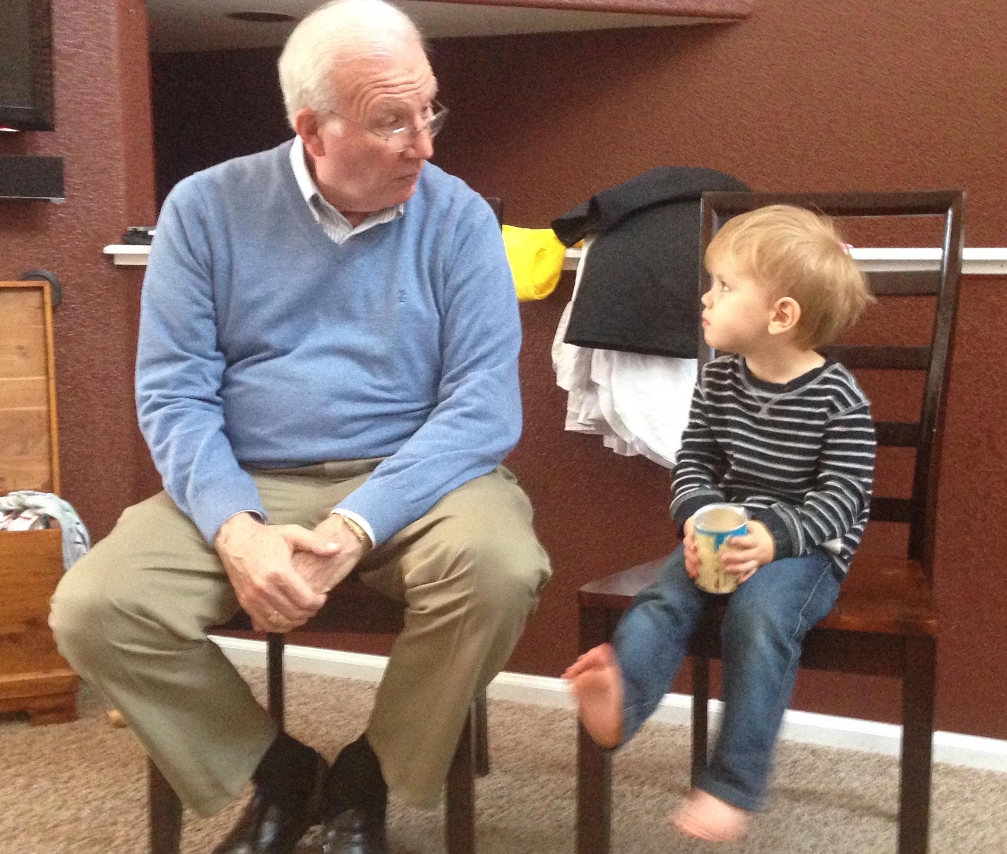 Papa in deep conversation with a grandboy
