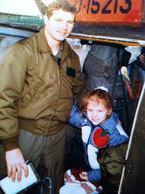 Julie A. Davis Veach (aprox. age 7) and her father, an Aviation Officer for the US Army.